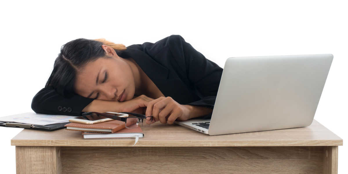 Photo of woman asleep at her desk